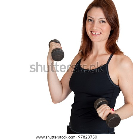 A beautiful woman working out with weights