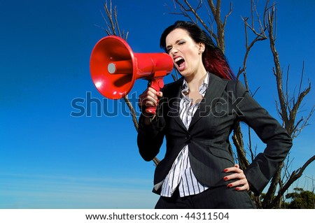 a beautiful woman yelling into a mega phone.