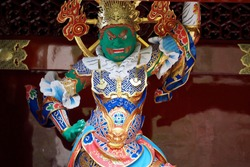 A beautiful wood carving statue depicting Japanese's god guardian with armor