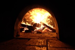 A beautiful wood fired oven with focus on fire.