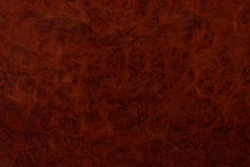 A beautiful wood grain effect with natural burl.  Use as a tileable backdrop.