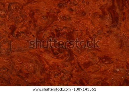 A beautiful wood grain effect with natural burl.  Use as a tileable backdrop pattern map.