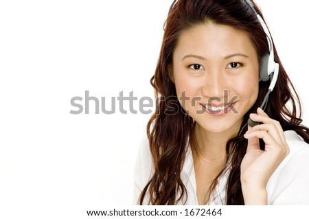 A beautiful young asian woman wearing a headset ready to communicate