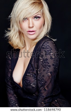 A beautiful young blond woman portrait studio. Staging adorable model. Makeup. Hairstyle.