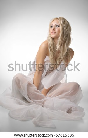 A beautiful young blonde in a white cloth