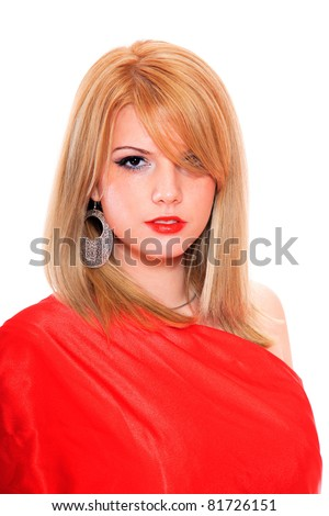 A beautiful young blonde woman in a bed of red silk sheets