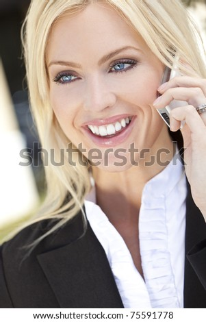 A beautiful young businesswoman smiling and talking on her cell phone