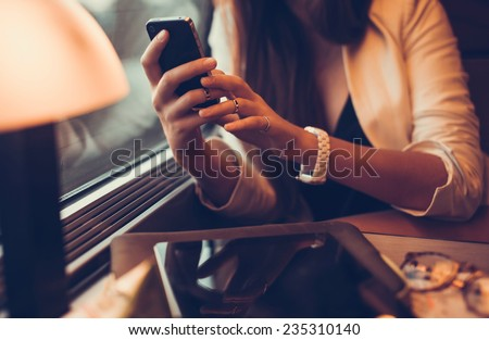 a beautiful young girl who works in the train on your smartphone, apple style, ipad and iphone, holding, cell cellular, hipster, travel, train