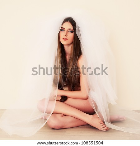 a beautiful young girl with long hair and veil