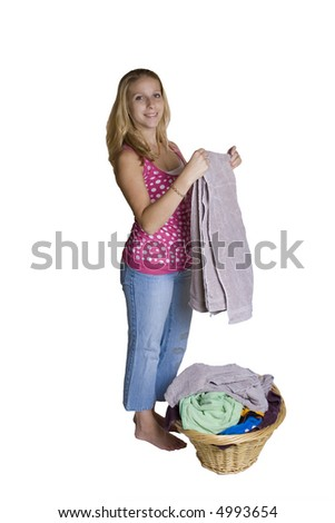 A beautiful young lady folding clothes