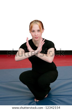 a beautiful young martial artist in a relaxed, ready state