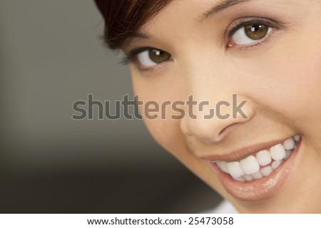 A beautiful young oriental woman with a wonderful toothy smile