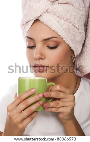 a beautiful young sexy nice woman with towel on head drinking coffee, isolated over white