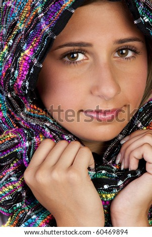 stock photo : a beautiful young teen girl wearing a multi-colored scarf ...
