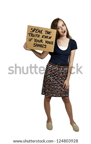 A beautiful young teenaged woman holding up a sign