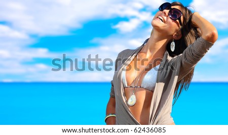 A beautiful young woman at the beach in Greece