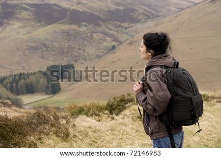 A beautiful young woman backpacking