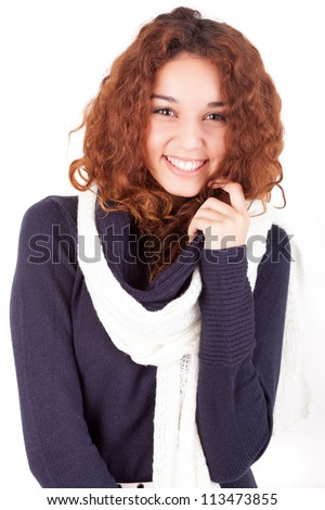 A beautiful young woman dressed for winter