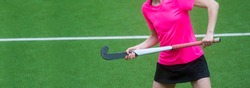 A beautiful young woman field hockey player