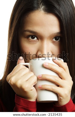A beautiful young woman holding a coffee cup