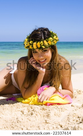 A beautiful young woman in a bikini on a Hawaiian beach
