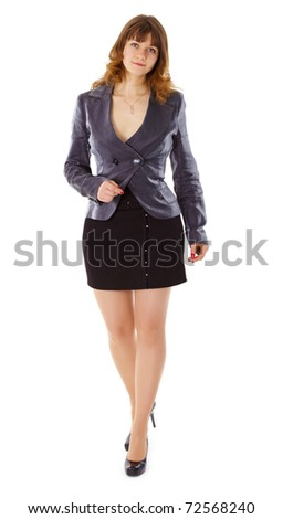 A beautiful young woman in a business suit isolated on white background