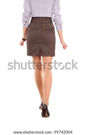 a beautiful young woman in business attire on a white background