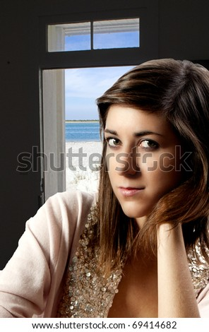A beautiful young woman looking far away