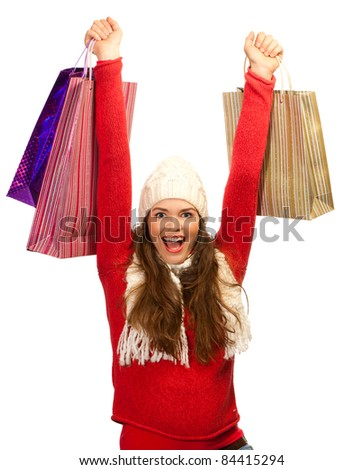 A beautiful young woman out shopping is thrilled to find the perfect gift