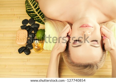 A beautiful young woman receiving facial massage at a spa salon. Perfect Skin. Skincare. Young Skin. Copy-space