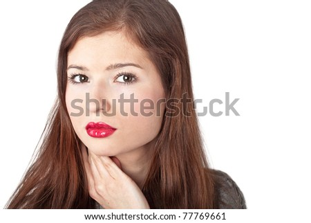 A beautiful young woman with red lips. Isolated on a white background