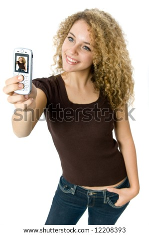 A beautiful young women taking a picture of herself with her mobile