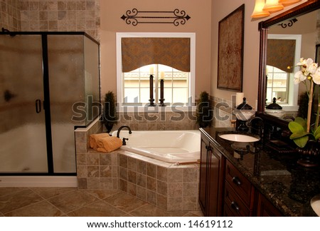 A beautifully decorated interior of a bathroom - stock photo