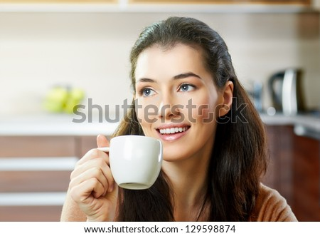 a beauty girl on the kitchen background