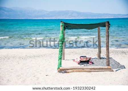 A bed under the shade on the Chrissi island, near Crete in Greece