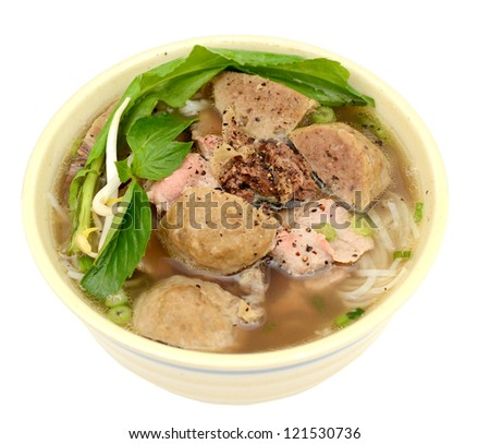 A beef and meatball of noodles soup bowl