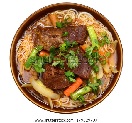 A beef noodle soup bowl isolated white
