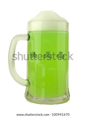 A beer mug of green beer with a foamy head on a white background - St. Patricks Day theme