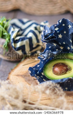 A beeswax food wrap covering avocado. Waste free. Eco friendly.