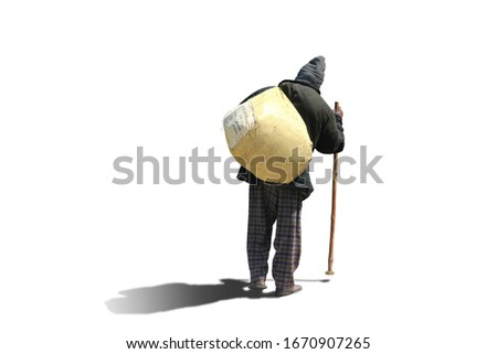 A beggar man with a bag over his shoulders and a stick goes on a white background with shadow. Stock photo ©