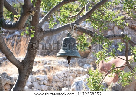 A bell hangs on a tree #1179358552