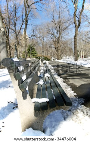A bench in Central Park in the wintertime.