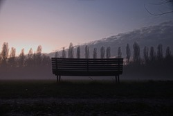 A bench in softly fog. a GoodDay ending  in Italy,