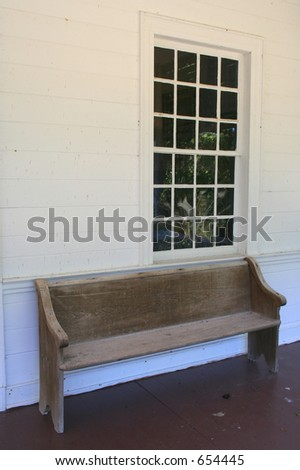 A bench on the front porch