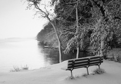 A bench overlooking early morning winter light and fog on the Illinois River, Starved Rock State Park