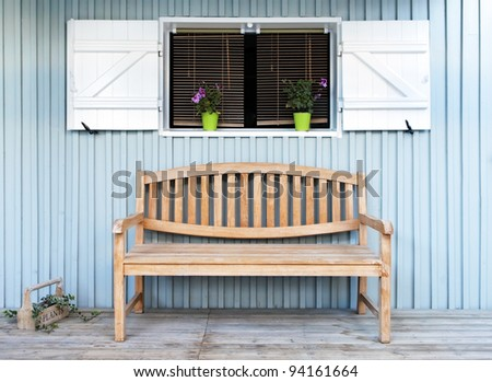 A bench seat on the veranda of a traditional house in the ostreycole village of Le Canon, France