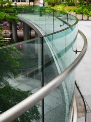 A bending frameless laminated glass railing and bending aluminium handrail.