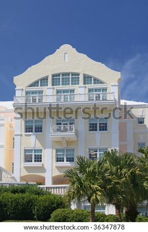 A Bermuda building, possibly offices or maybe apartments, with typical Bermuda colors and architectural features