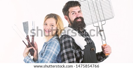A better grill for a better cook. Happy hipster and sexi girl holding picnic set for barbecue. Family couple having picnic party. Sexy woman and bearded man enjoying picnic or cookout. Family picnic. #1475854766
