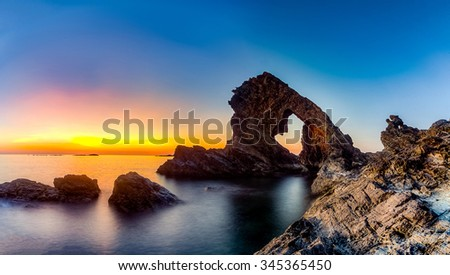 A Beutiful Sunrise in Ban Than Beach, Tam Hai Island, Quang Nam, Vietnam.Ban Than Beach is a beautiful beach with many special rocks and stones. Tam Hai Island is a new place for visit in Quang Nam.  #345365450